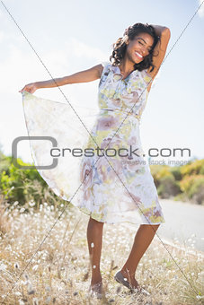 Beautiful woman in floral dress smiling at camera