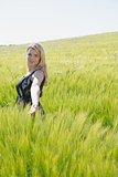 Pretty blonde in sundress standing in wheat field