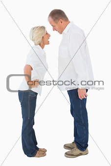 Angry older couple arguing with each other