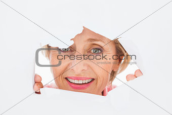 Older woman looking through rip