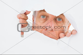 Older man looking through rip
