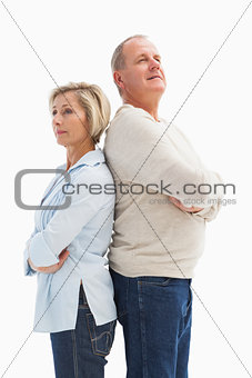 Mature couple standing and thinking