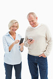 Happy mature couple using their smartphones