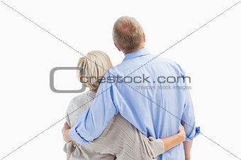 Mature couple hugging and looking