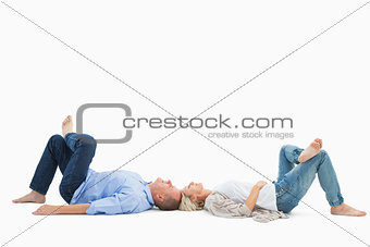 Mature couple lying and smiling