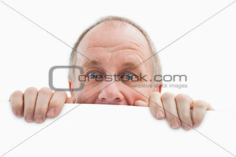 Mature man looking over card