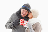 Happy mature couple in winter clothes holding mugs