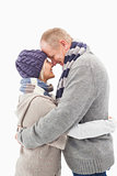 Happy mature couple in winter clothes hugging