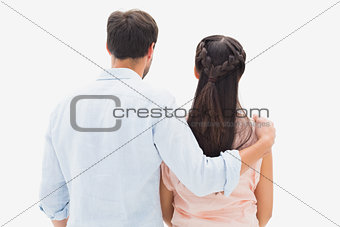 Attractive young couple standing and looking
