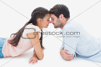 Attractive young couple smiling at each other