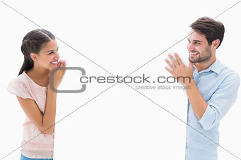 Attractive young couple smiling and holding poster