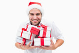 Handsome festive man holding gifts