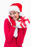 Beautiful festive woman holding gift
