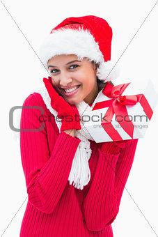 Beautiful festive woman holding gift