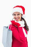 Beautiful festive woman holding shopping bag