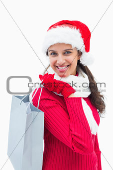 Beautiful festive woman holding shopping bag