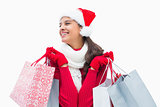 Beautiful festive woman holding shopping bags