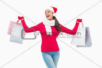 Beautiful festive woman holding shopping bags