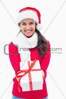 Beautiful festive woman offering gift