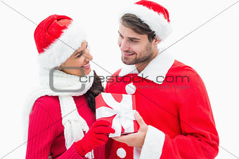 Attractive festive couple holding a gift