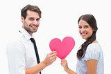 Pretty brunette giving boyfriend her heart