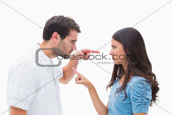 Angry couple pointing at each other