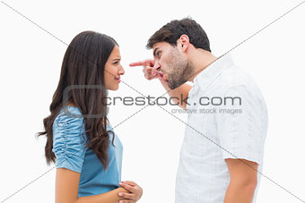 Angry man shouting at upset girlfriend