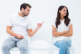 Man pleading with angry girlfriend