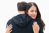 Unhappy brunette hugging her boyfriend
