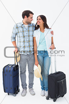 Attractive young couple going on their holidays