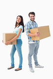 Happy young couple with moving boxes