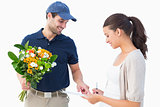 Happy flower delivery man with customer