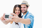 Happy hipster couple taking a selfie
