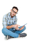 Handsome hipster using tablet pc