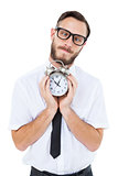 Geeky businessman holding alarm clock