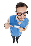 Geeky hipster looking at camera pointing at card