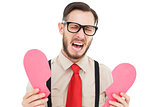 Geeky hipster crying and holding broken heart card