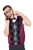 Geeky hipster talking on a retro cellphone