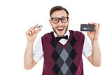 Geeky hipster holding a retro tape cassette player