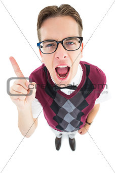 Angry geeky hipster pointing at camera
