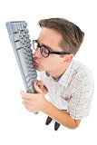 Geeky hipster kissing his keyboard