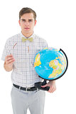 Geeky hipster holding a globe