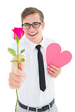 Geeky hipster holding a red rose and heart card