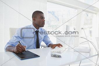 Focused businessman working at his desk