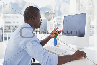 Focused businessman working at his desk on video chat