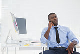 Businessman sitting at his desk on the phone