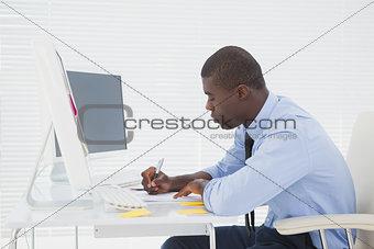 Focused businessman sitting at his desk working