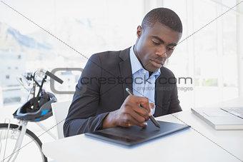 Focused designer drawing on digitizer