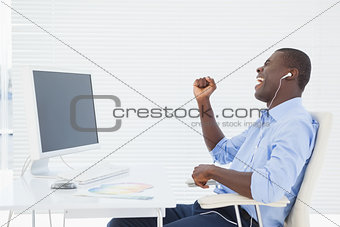 Businessman listening to music while he works