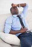 Tired businessman getting a headache